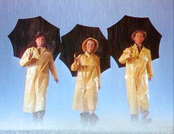 """Gene Kelly, Debbie Reynolds i Donald O'Connor w """"Deszczowej piosence"""""""