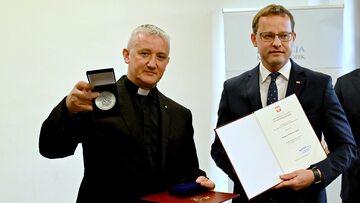 ks. Tomasz Kancelarczyk, Marcin Romanowski