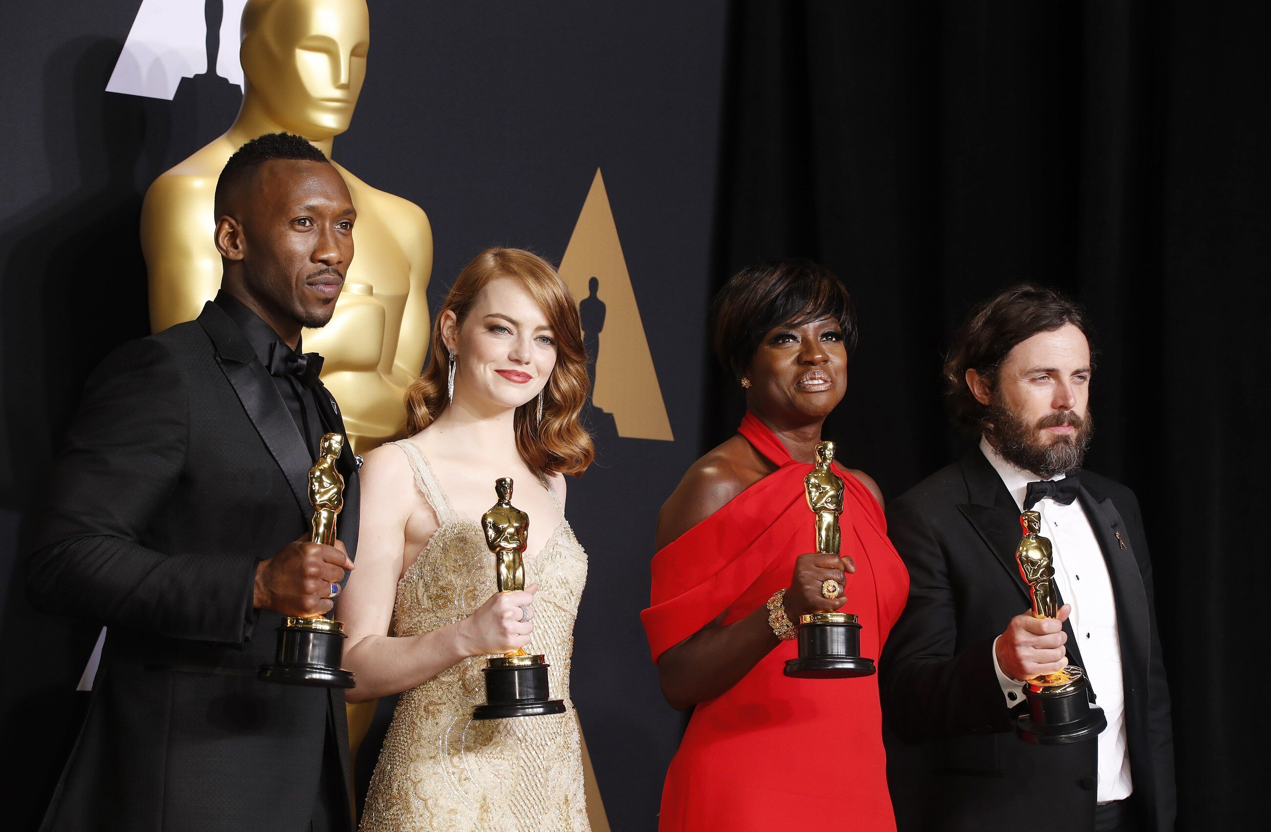 (L-R) Mahershala Ali (Actor in a Supporting Role for Moonlight), Emma Stone (Actress in a Leading Role for La La Land), Viola Davis (Actress in a Supporting Role for Fences) and Casey Affleck (Actor in a Leading Role for Manchester by the Sea)